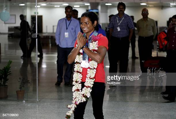 Indian spinter Dutee Chand faliciated by the public and sports students after her arrive in her home town after qualifing for the Rio Olympic at the...