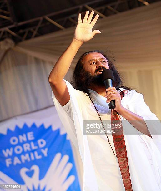 Indian spiritual guru and Art of Living Foundation leader Sri Sri Ravi Shankar delivers a speech during 'An Evening of Wisdom and Meditation' lecture...