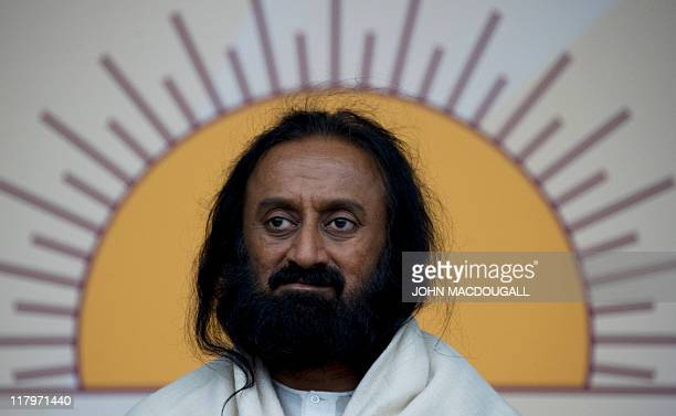 Indian spiritual leader Sri Sri Ravi Shankar attends the World Culture Festival at Berlin's Olympiastadion July 2 2011 Thousands of people showed up...