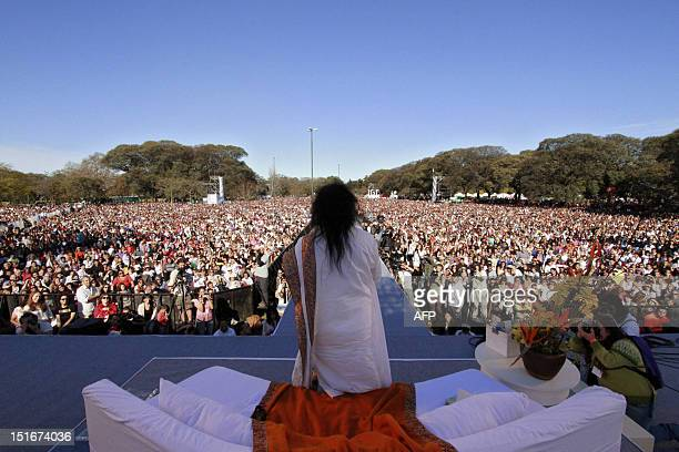Indian spiritual leader Sri Sri Ravi Shankar leads a massive meditation in Buenos Aires on September 9 2012 120000 people meditated 'for a society...