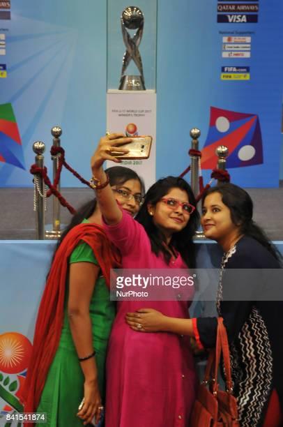 Indian Sports lovers his mobile Selfie at The FIFA U17 World Cup 2017 Winners Trophy visit in Kolkata City on September 012017 at Kolkata Khudiram...