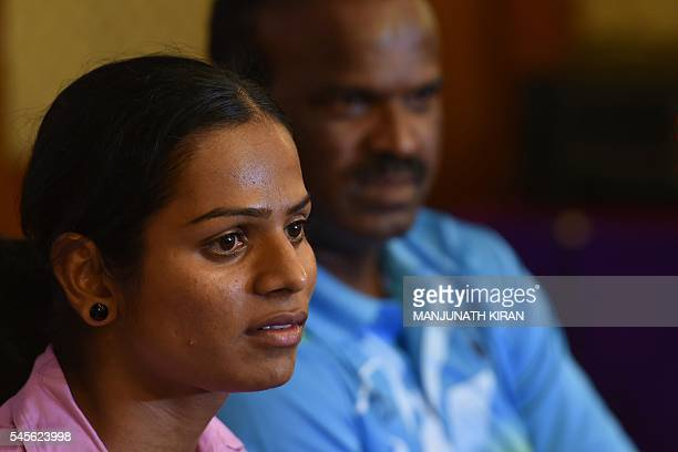 Indian sprinter Dutee Chand who has qualified for the Women's 100 meters event at the Summer Olympic Games looks on during a press conference in...