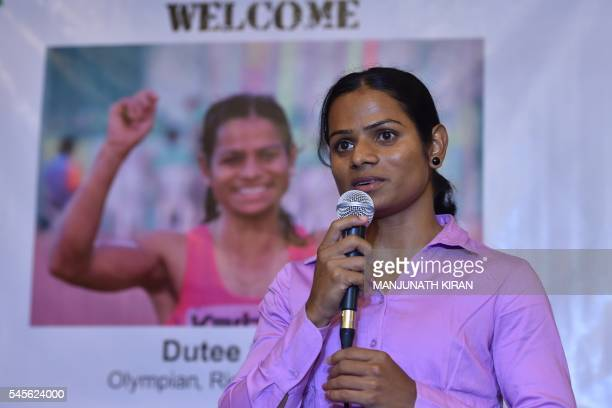 Indian sprinter Dutee Chand who has qualified for the Women's 100 meters event at the Summer Olympic Games addresses a press conference in Bangalore...