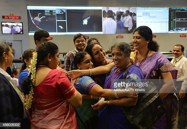 Indian staff from the Indian Space Research Organisation celebrate after the Mars Orbiter Spacecraft successfully entered the Mars orbit at the ISRO...