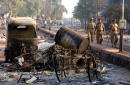 Indian state police patrol the streets of Ahmadabad India after rioting between Muslims and Hindus March 1 2002 in Ahmadabad India two days after a...