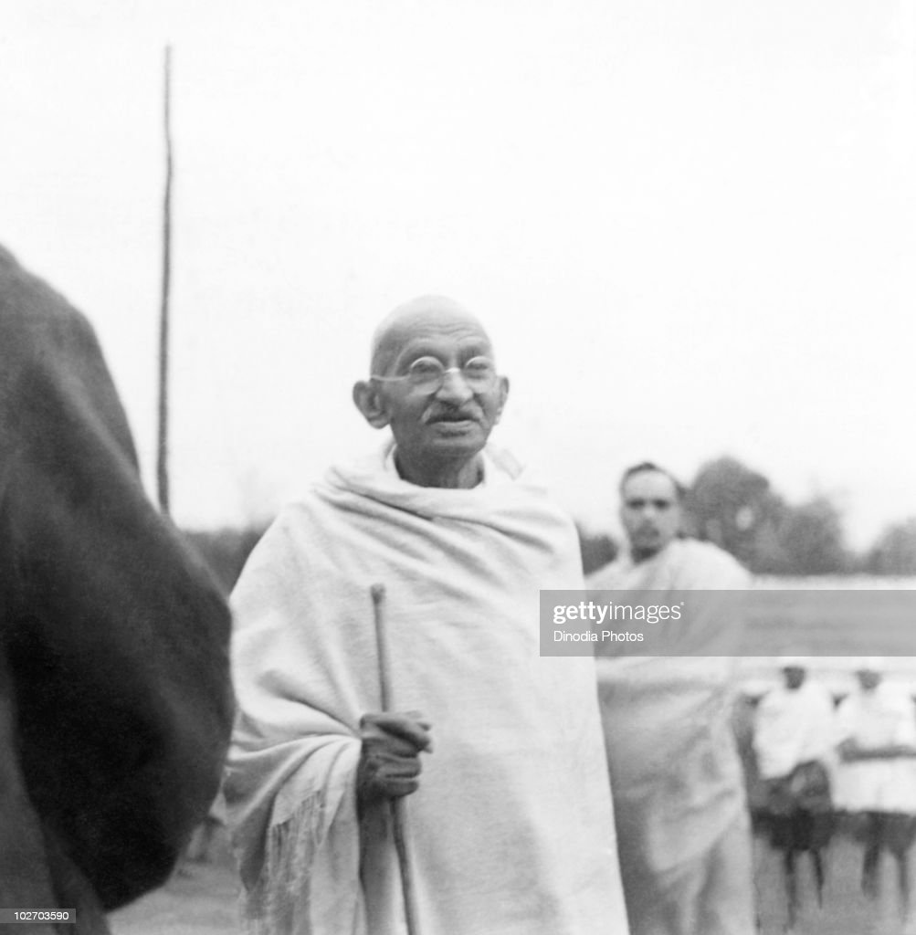 Indian statesman and activist Mohandas Karamchand Gandhi (1869 - 1948) at Ramgarh, 1939. With him is Deepak Chaudhry, son of Saraladevi Chaudhry, a relative of Rabindranath Tagore.