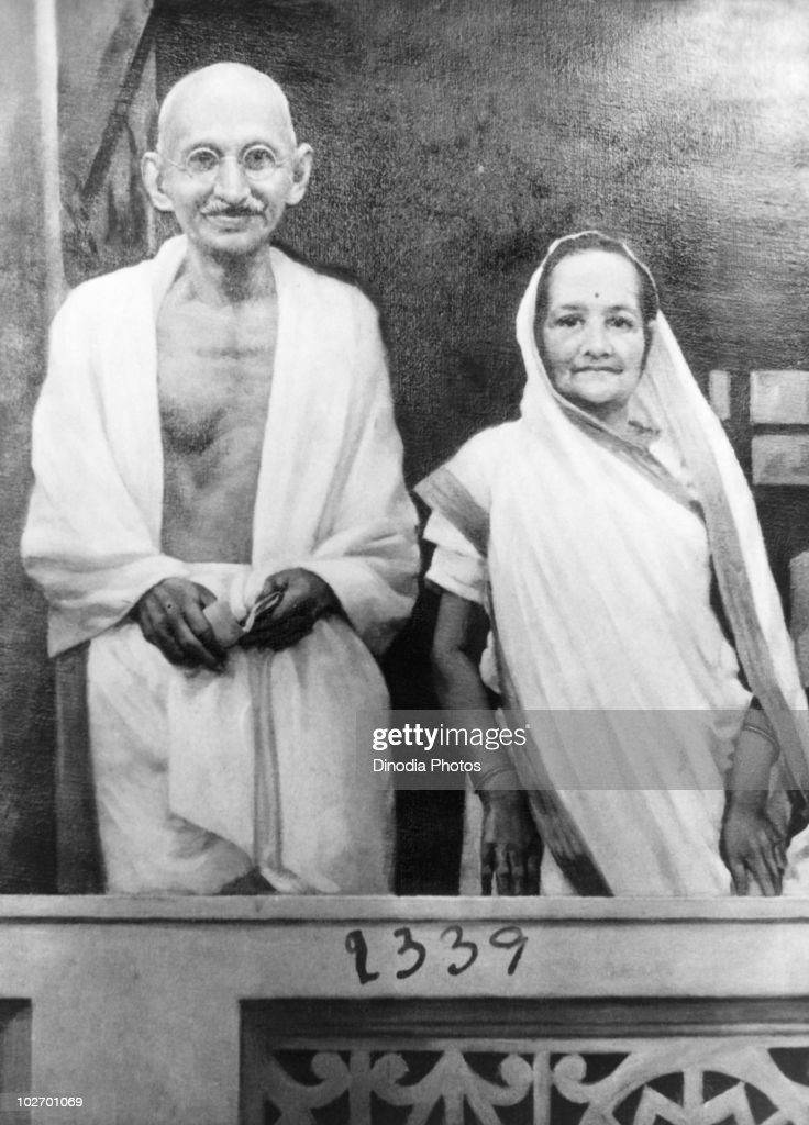 Indian statesman and activist Mohandas Karamchand Gandhi (1869 - 1948) standing on a balcony in India with his wife <a gi-track='captionPersonalityLinkClicked' href=/galleries/search?phrase=Kasturba+Gandhi+-+Activist&family=editorial&specificpeople=6408444 ng-click='$event.stopPropagation()'>Kasturba Gandhi</a> (1869 - 1944), 1940.