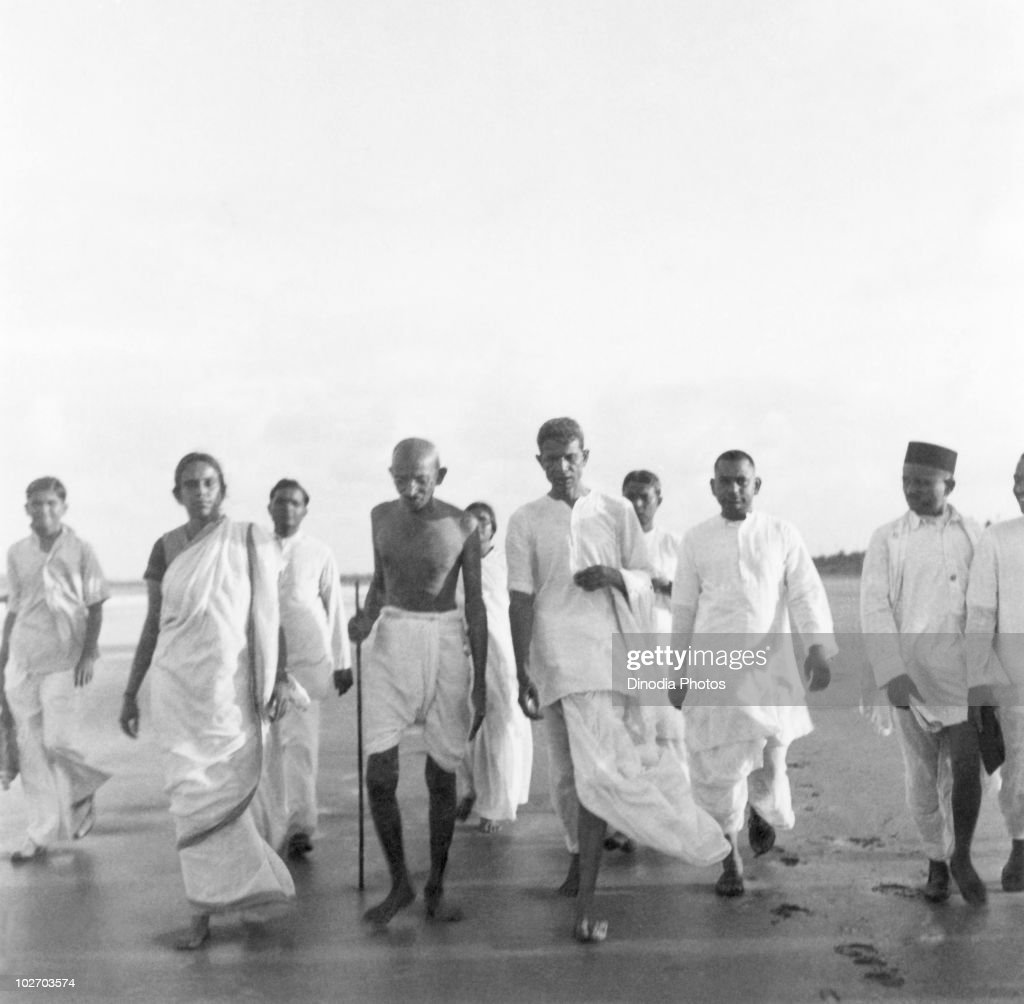 Indian statesman and activist Mohandas Karamchand Gandhi walking on Juhu Beach Mumbai May 1944