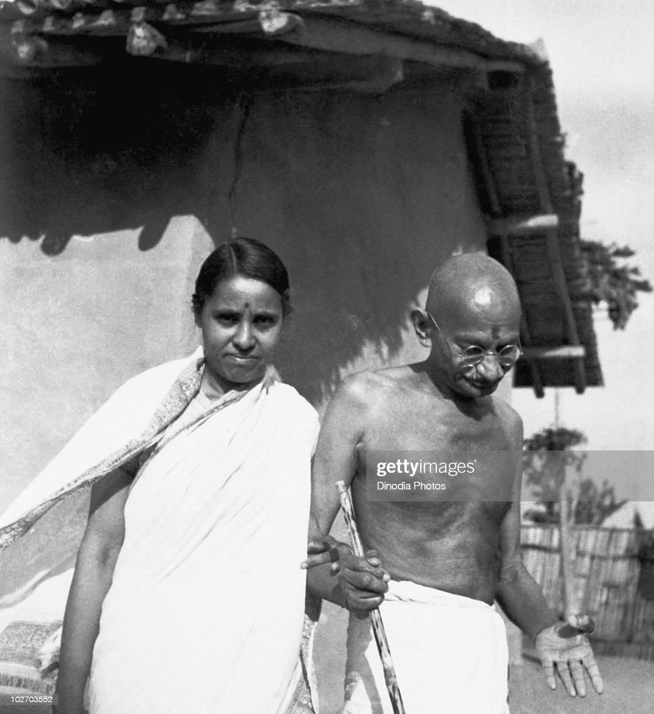 Indian statesman and activist Mohandas Karamchand Gandhi (1869 - 1948) with Premabehn Kantak in front of his hut at Sevagram Ashram, 1942.