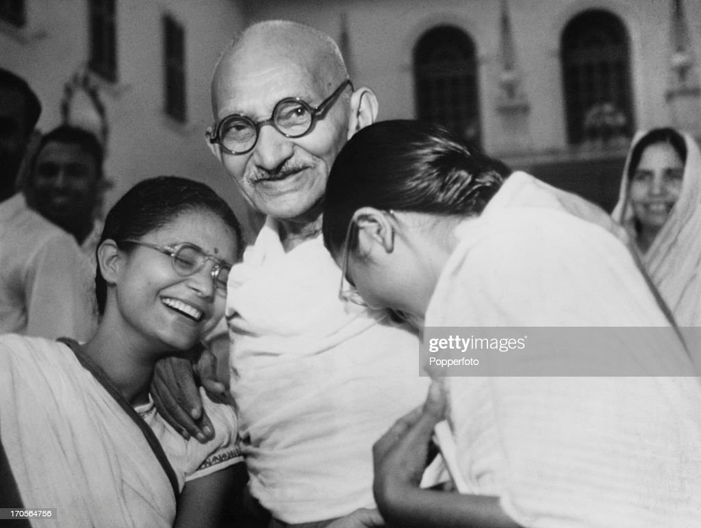 Indian statesman and activist Mohandas Karamchand Gandhi with two of his grandaughters at Birla House in New Delhi India circa 1945