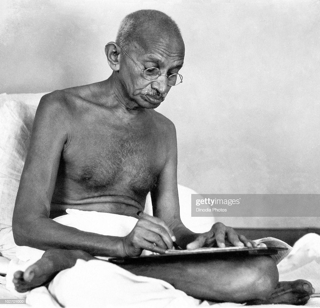 Indian statesman and activist Mohandas Karamchand Gandhi (1869 - 1948) writing at Birla House, Mumbai, August 1942.