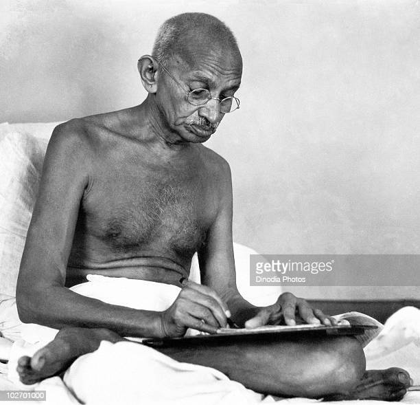 Indian statesman and activist Mohandas Karamchand Gandhi writing at Birla House Mumbai August 1942
