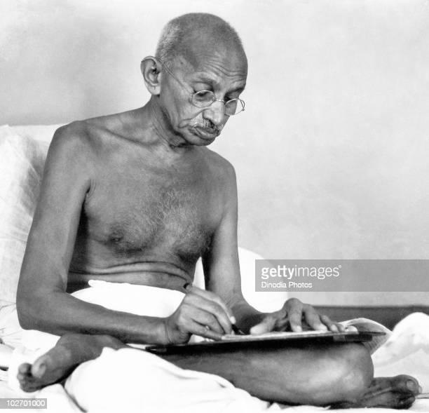 Indian statesman and activist Mohandas Karamchand Gandhi writing at Birla House Mumbai August 1942