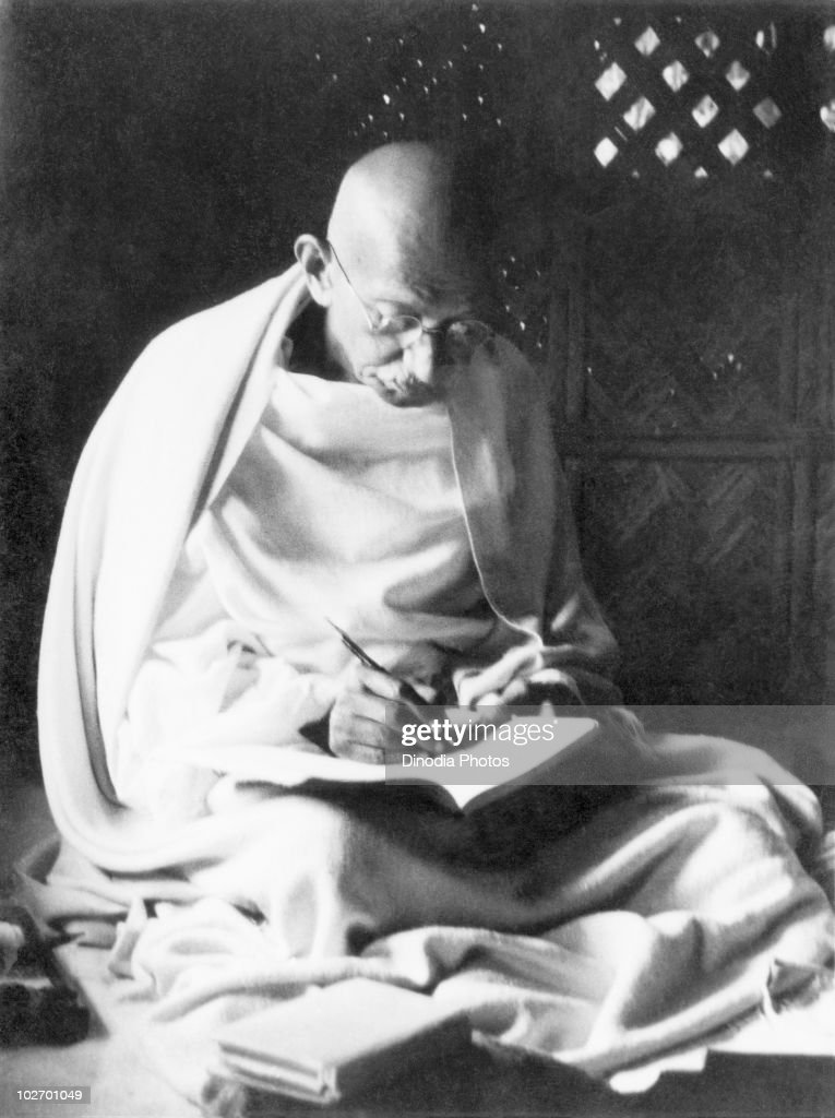 Indian statesman and activist Mohandas Karamchand Gandhi writing during his stay in the riotaffected area of Noakhali in modern Bangladesh November...
