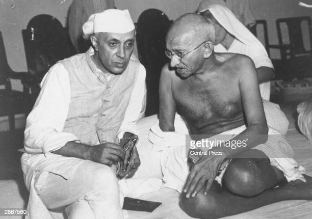 Indian statesmen Mahatma Gandhi and Jawaharlal Nehru known as Pandit Nehru in conversation at the AllIndia Congress committee meeting at Bombay