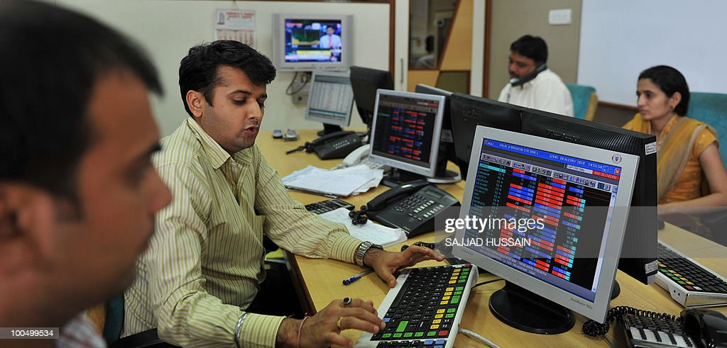 Indian stockbrokers trade at a brokerage firm in Mumbai on May 25, 2010. Indian shares fell over three percent intraday, to a three-month-low of below 16,000 points level, as foreign funds sold riskier equities amid a deepening to Europe's debt woes.The benchmark 30-share Sensex index was down 509.4 points to a day's low of 15,960.15, half an hour prior to its close. AFP PHOTO/Sajjad HUSSAIN