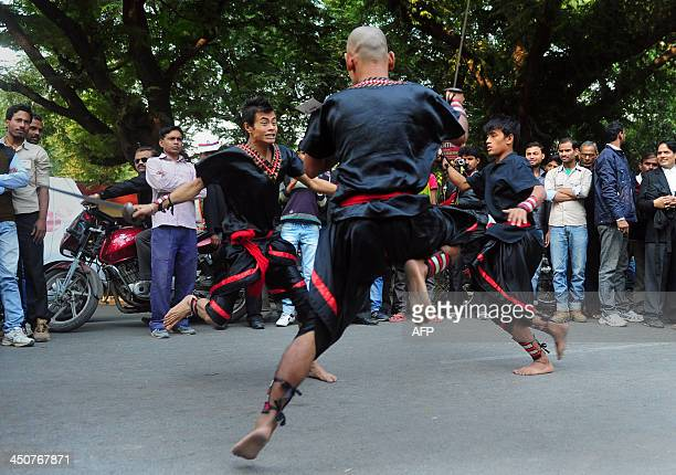 Indian street artists from the state of Manipur perform martial arts during the 'Theatre March' held as part of the 44th national multilingual short...