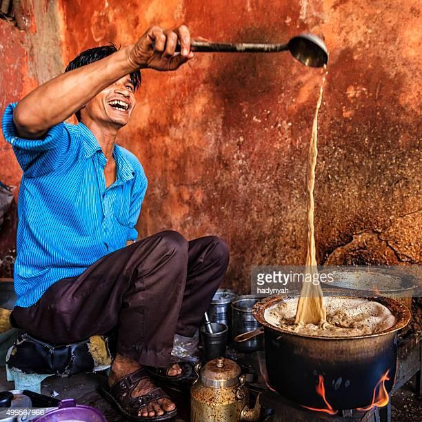 Indian street seller selling tea - masala chai in Jaipur