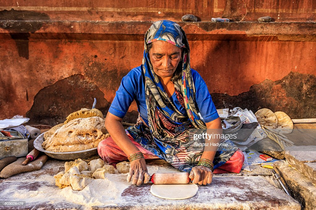 Indian street vendor preparing chapatti