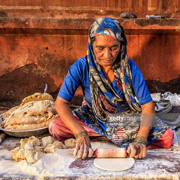 Indian street vendor preparing food - chapatti, flat bread