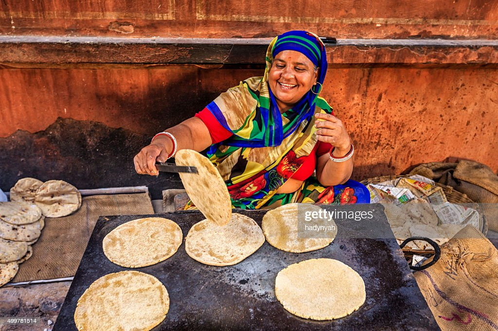 Indian street vendor preparing food - chapatti, flat bread