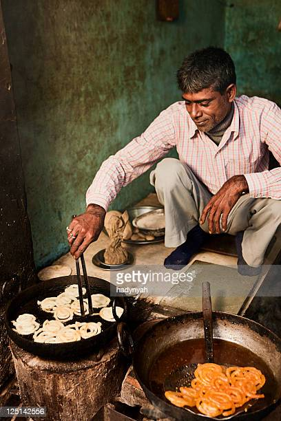 Indian street vendor preparing food - jalebi