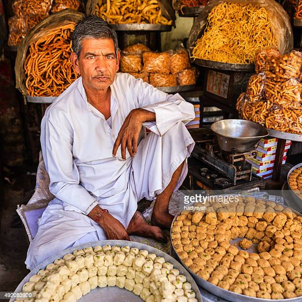 Indian street vendor seeling sweets near Jaipur, India