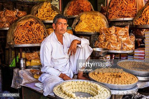 Indian street vendor selling sweets near Jaipur, India