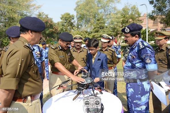 TOPSHOT Indian student Harshwardhan Zala meets with Central Reserve Police Force officers to show them a drone he has designed at the Rapid Action...