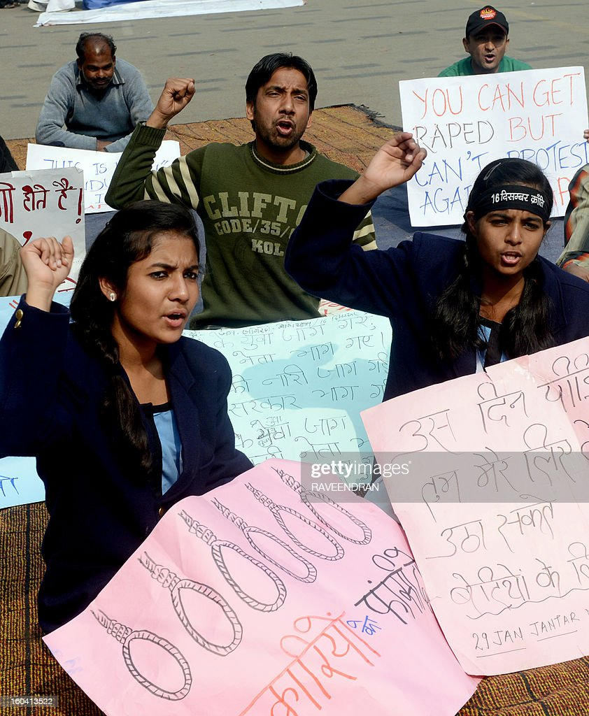 Indian student protestors hold placards as they shout slogans during a protest against last month's gang rape and murder of a student, in New Delhi on January 31, 2013. Verdicts for five men accused of the fatal gang-rape of a student on a New Delhi bus would be handed down 'very soon,' a defence lawyer said , as an application to relocate the trial failed. AFP PHOTO/RAVEENDRAN