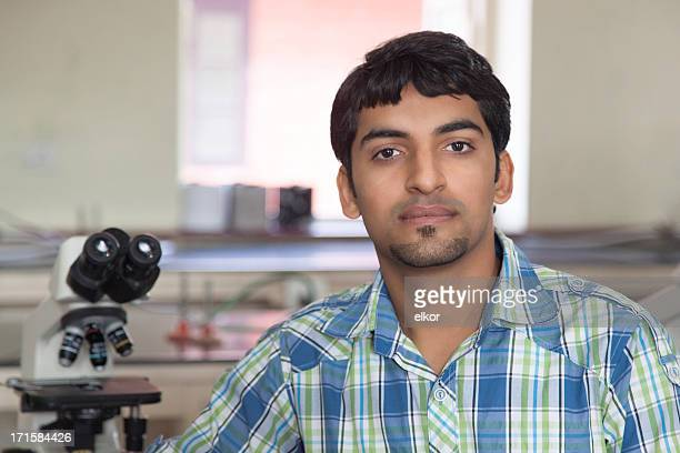 Indian Student With Microscope In A Laboratory