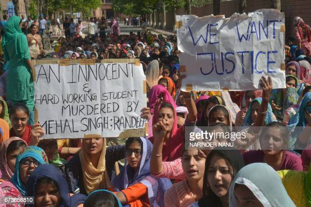 Indian students and supporters of student Harpreet Singh gather outside Khalsa College in Amritsar on April 27 after Singh committed suicide...