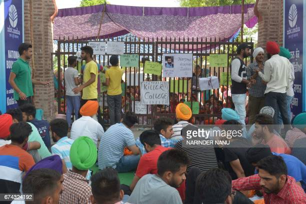 Indian students and supporters of student Harpreet Singh gather outside Khalsa College in Amritsar on April 28 after Singh committed suicide...