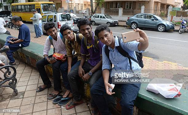 Indian students click a selfie at a designated 'selfie point' in Mumbai on June 16 2015 Selfies have become a global phenomenon with users rarely...