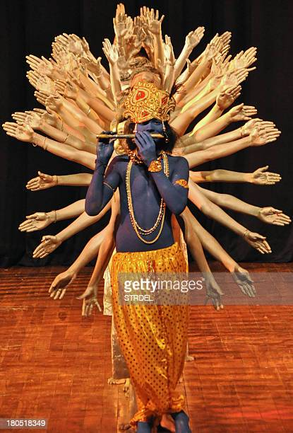Indian students dressed as Hindu God Lord Krishna perform onstage in Jammu on September 14 2013 The performance by Indian youths held as part of a...