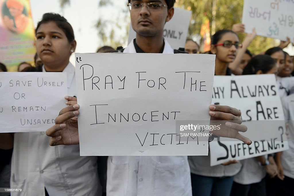 Indian students from the Ahmedabad Institute of Medical Sciences (AIMS) stage a peaceful protest to support a New Delhi student that was raped inside a moving bus last week, on Sarkhej - Gandhinagar Highway near Ahmedabad on December 22, 2012. Protesters, demonstrated across India for a sixth day, following the brutal gang-rape of a student last weekend in New Delhi. AFP PHOTO / Sam PANTHAKY