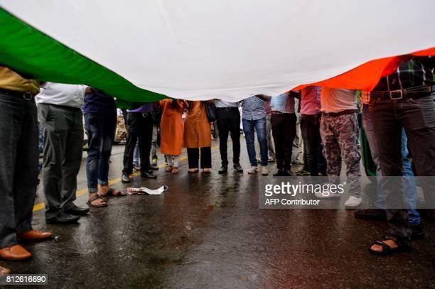 Indian students from the Akhil Bharatiya Vidyarthi Parishad the student wing of the country's ruling Bharatiya Janata Party carry India's national...