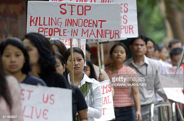 Indian students from the country's northeastern state of Manipur take part in a rally in Bangalore 13 August 2004 to protest against the alleged...
