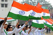 Indian students hold national flags during an event to mark the country's 66th Republic Day parade in Amritsar on January 262015 US President Barack...
