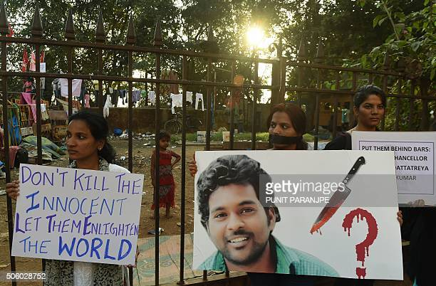 Indian students hold placards as they take part in a silent protest after a student found was dead at a university hostel in Mumbai on January 21...
