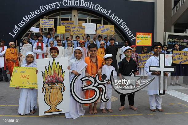 Indian students holds a poster highlighting India's 'Unity in Diversity' while spreading the message of peace in Ahmedabad on September 30 2010 ahead...