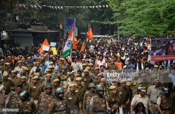 Indian students of Akhil Bharatiya Vidyarthi Parishad the student wing of the country's ruling Bharatiya Janata Party shout slogans as they carry...