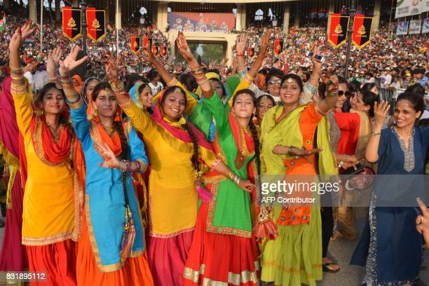 Indian students perform a dance during a ceremony to mark India's 70th Independence Day celebrations at the IndiaPakistan Wagah border post on August...