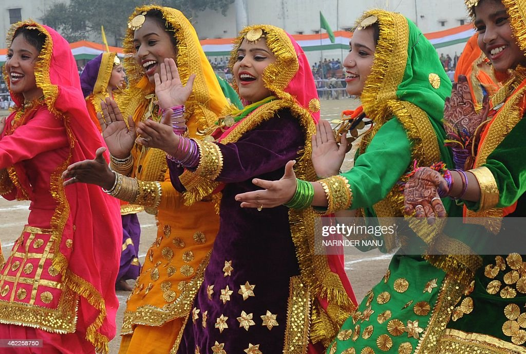 Indian students perform a traditional folk dance during an event to mark the country's 66th Republic Day parade in Amritsar on January 262015 US...