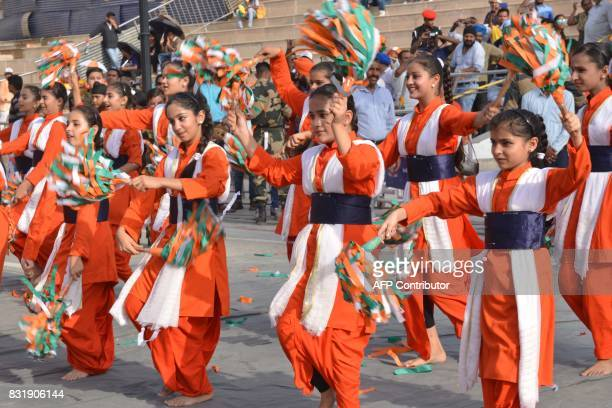 Indian students perform during a ceremony to mark the 70th anniversary of India's Independence Day at the IndiaPakistan Wagah border post on August...