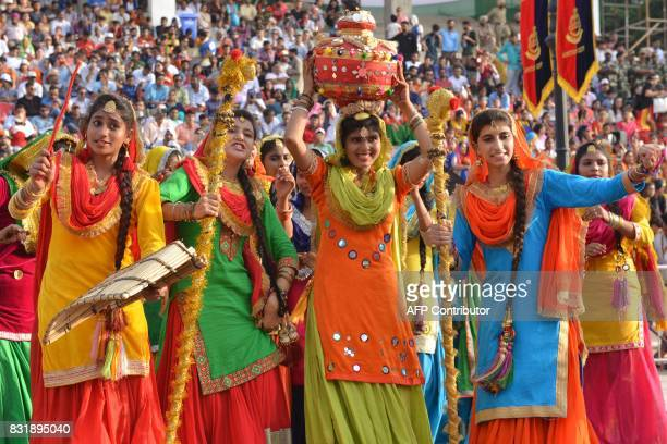 Indian Students perform the Punjabi Giddha dance during a ceremony to mark India's 70th Independence Day celebrations at the IndiaPakistan Wagah...