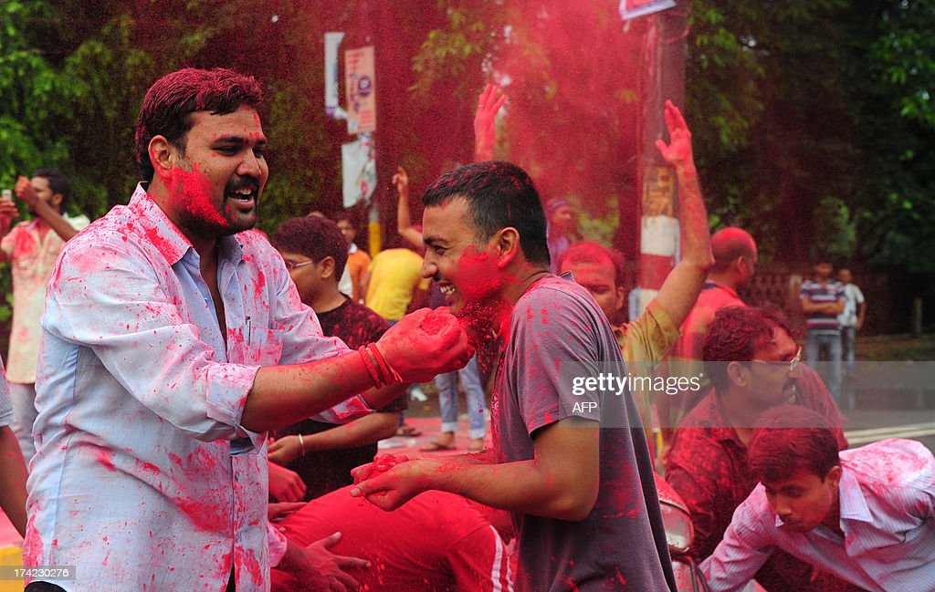 Indian students play with colours as they celebrate after Allahabad High Court reserved its order on proposed reservation in the Uttar Pradesh Public Service Commission (UPPSC) in Allahabad on July 22, 2013. The controversial reservation policy introduced recently in Uttar Pradesh whereby caste-based quotas were introduced at the preliminary stage itself, led to violent protests in the city over the issue.