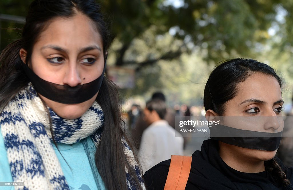 Indian students protestors pray for rape victim during a protest demanding better security for women in New Delhi on December 29, 2012, as Indian leaders appealled for calm fearing fresh outbursts of protests after the death of a gang-rape student victim. New Delhi's top police officer and chief minister have urged people to mourn the death of a gang-rape victim in a peaceful manner as large parts of the city-centre were sealed off. The calls for calm came after an Indian woman who was gang-raped on a New Delhi bus died in a Singapore hospital after suffering severe organ failure.