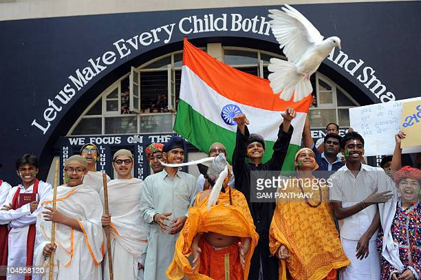 Indian students release white pigeons during the 'Unity in Diversity' event to spread the message of peace in Ahmedabad on September 30 2010 ahead of...