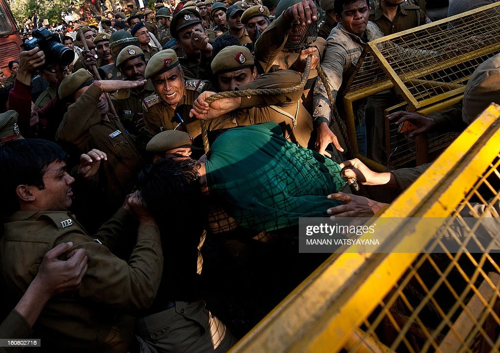 Indian students scuffle with policemen as they are sprayed with water-canon during a protest outside the Sri Ram College of Commerce in New Delhi on February 6, 2013. Indian riot police fired water cannon on Wednesday at hundreds of students outside a college in New Delhi who were protesting at an appearance by hardline nationalist politician Narendra Modi. Modi, tipped to be the main opposition Bharatiya Janata Party's (BJP) candidate for prime minister in elections next year, was speaking at the Sri Ram College of Commerce.